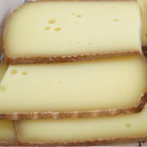 Fromage à raclette au lait cru 50%, raclette fumée 50% (environ 400 g)